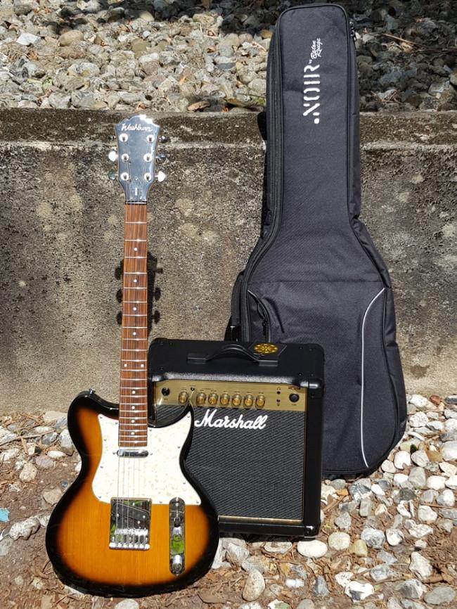 el guitar med forstærker